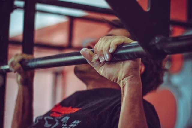 A man doing pullups.