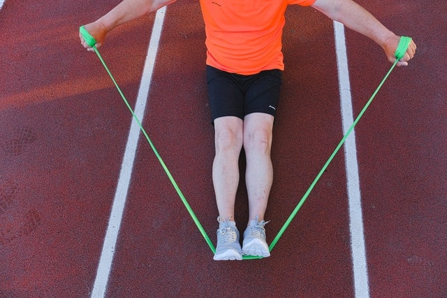 A man training with a resistance band.