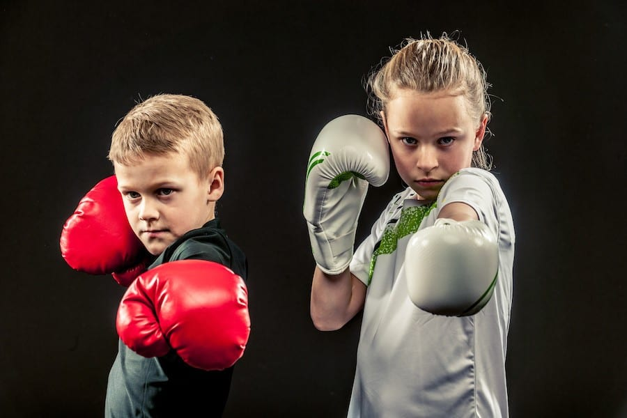A couple of kids have a box training