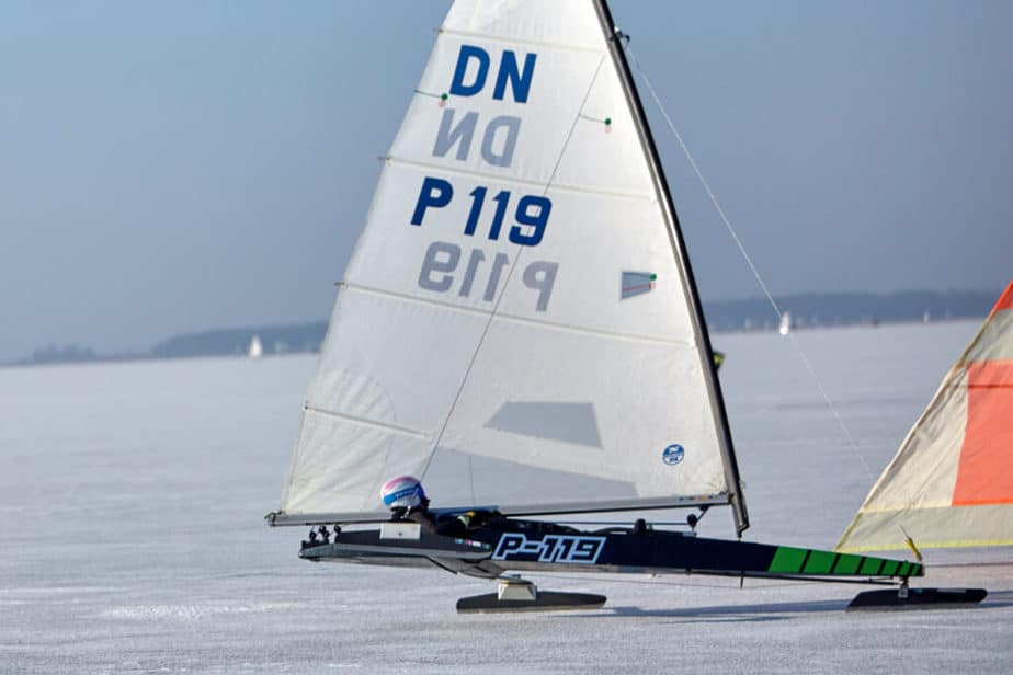 A sailboat on a frozen lake