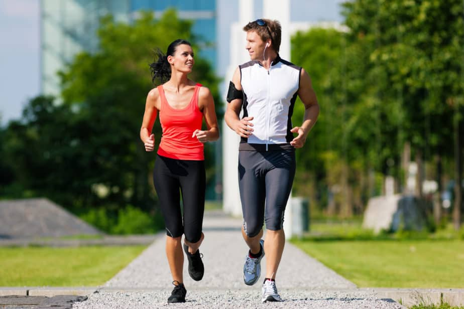 A young couple is running