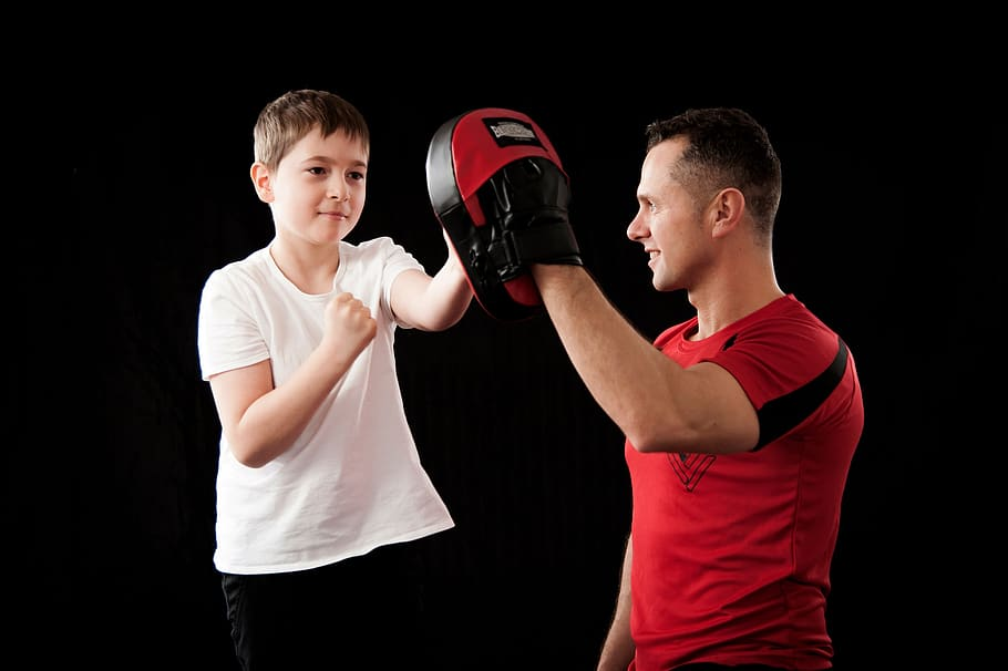 A boy is teaching self defence in boxing
