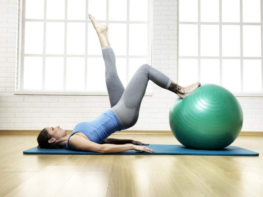 A girl is having a Pilates training.