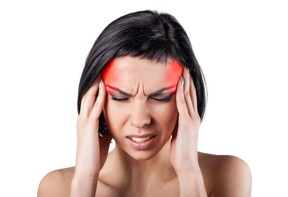 A girl has a migraine pain.