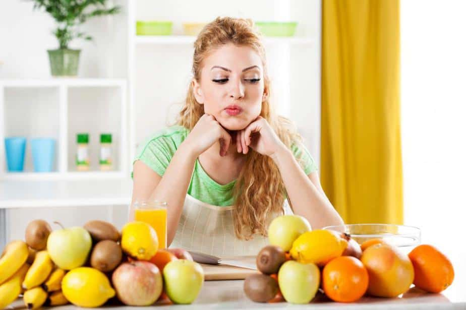 A girl is eating fruit.