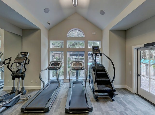 Several heavy treadmills in a home.