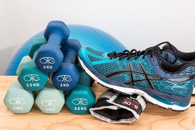 Dumbells, sneakers, and ankle weight.