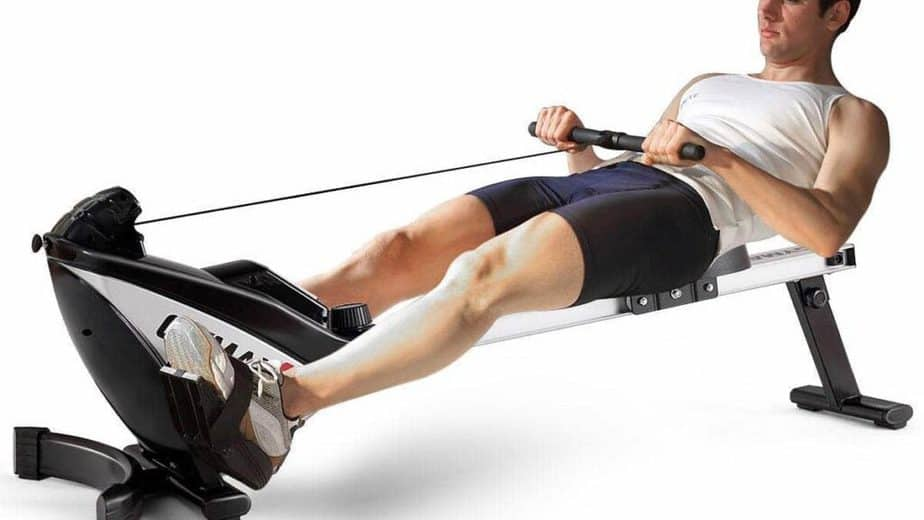 A guy is having training on rowing machine.