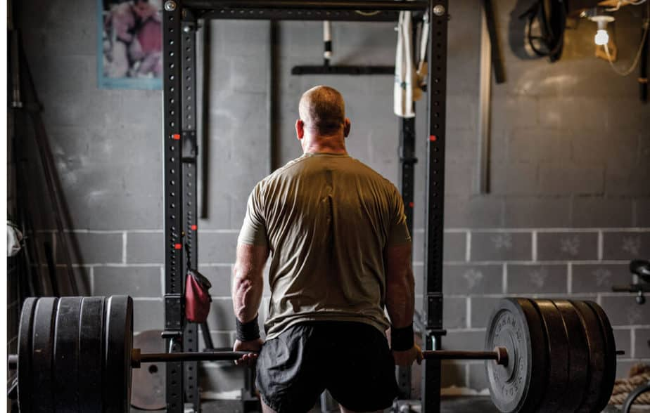 A man has a training in a functional space at the garage.