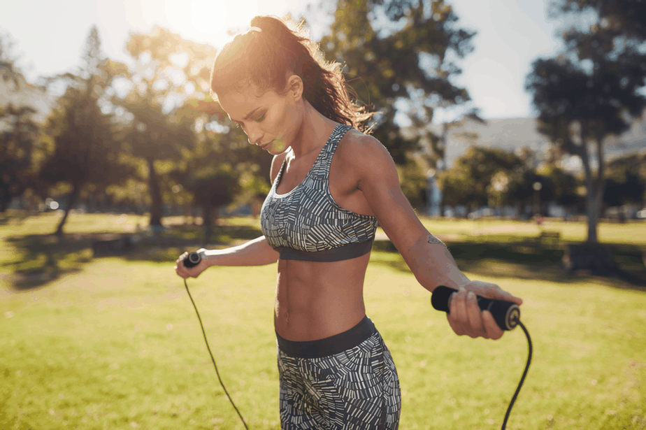 A girl has a training jump rope outside.