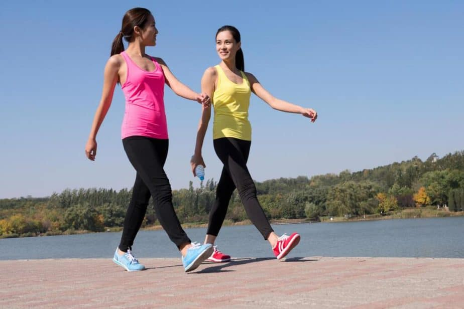 Two girls are walking - one of the protein diet phase.