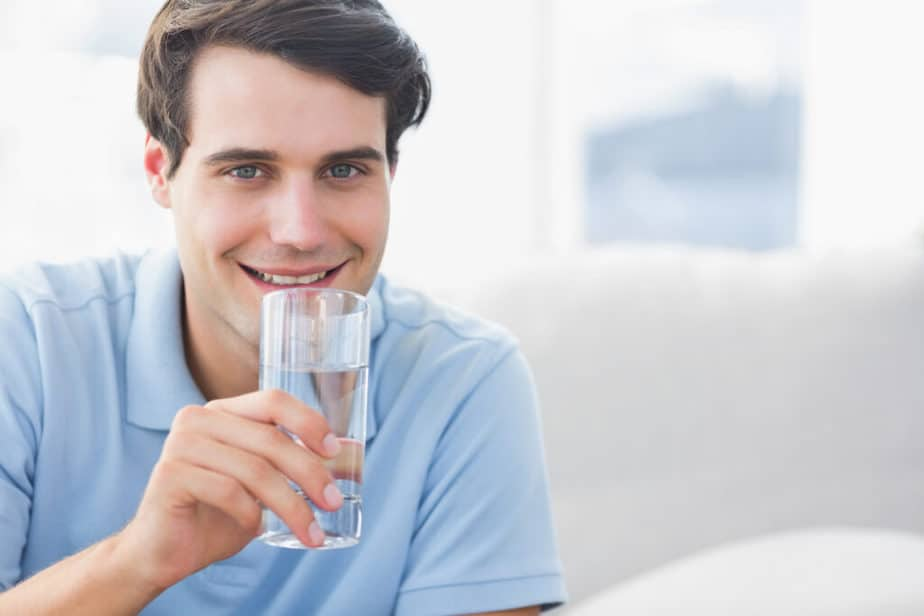 a man drinking water to beat fatigue