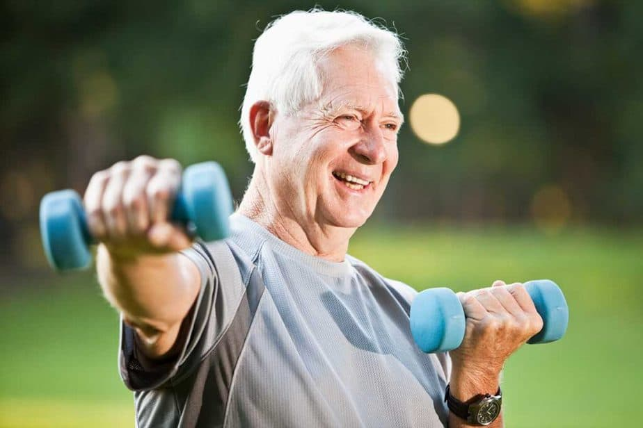 An old man has a training outside - latest fitness trend.