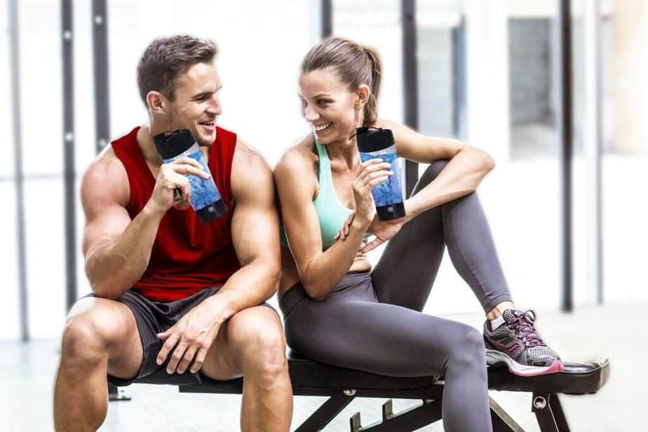 A couple is drinking shake at the gym for better success at fitness