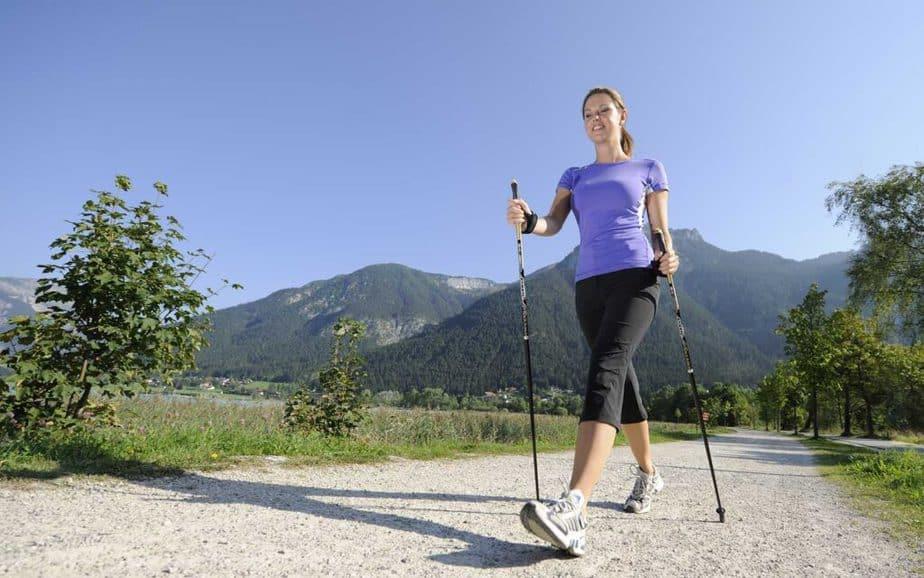 A girl has Nordic walking training.