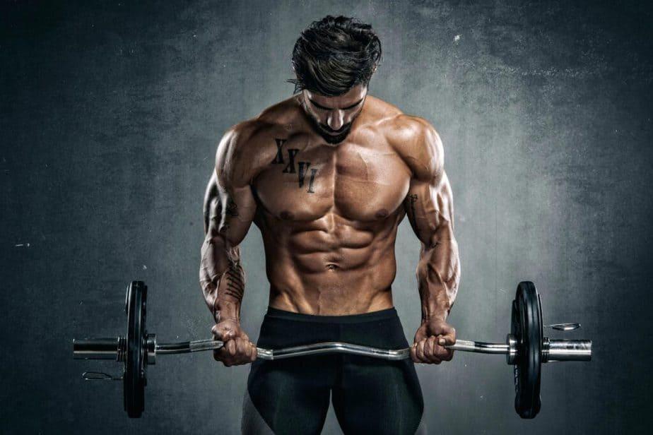 A guy has a training with weightliftnig.