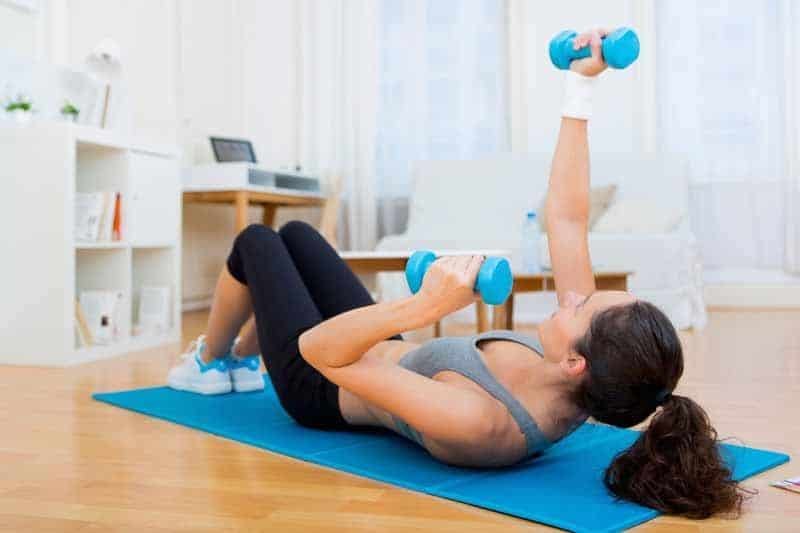 A girl has light exercise at home.
