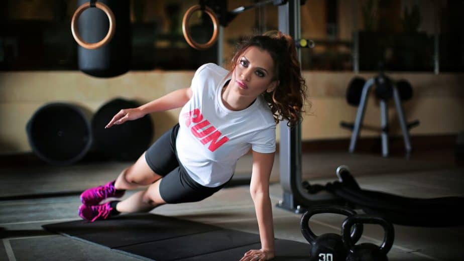 A girl has a training at the gym.