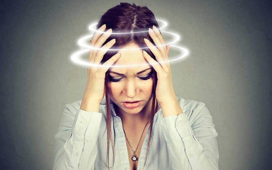 A girl has dizziness - one of possible signs.
