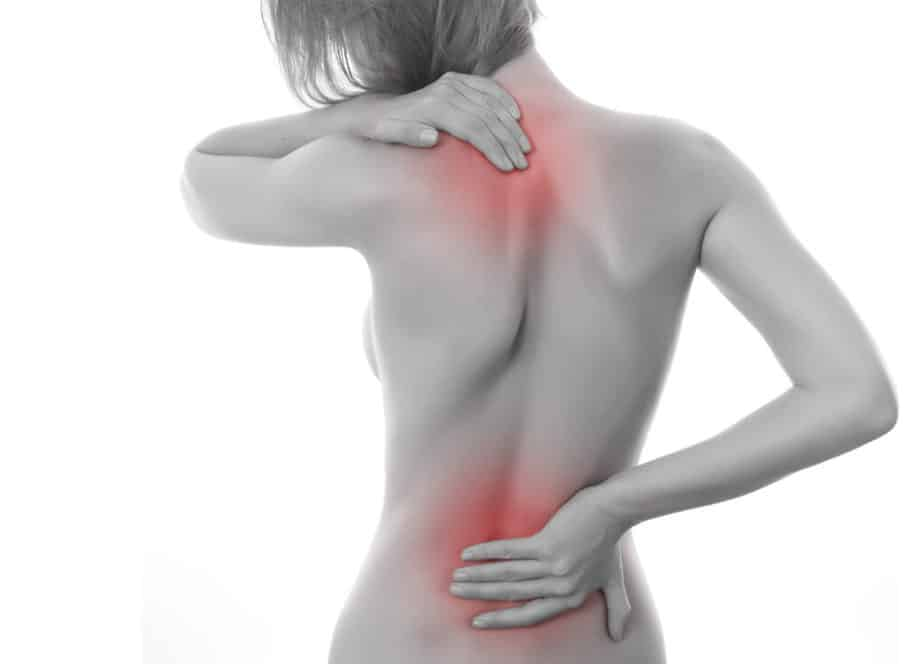 A girl has a pain in neck and waist area.