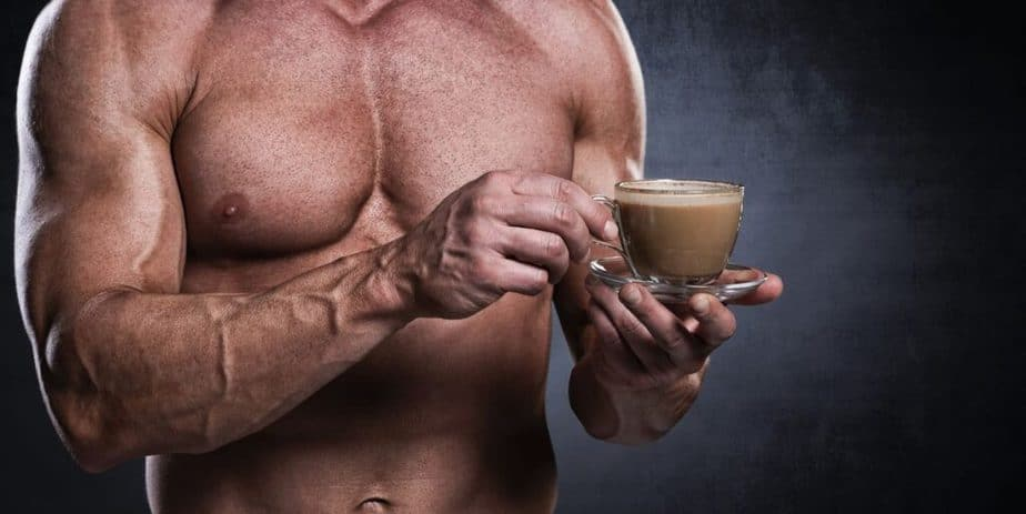 A bodybuilder is taking caffeine at the gym for better success in fitness.