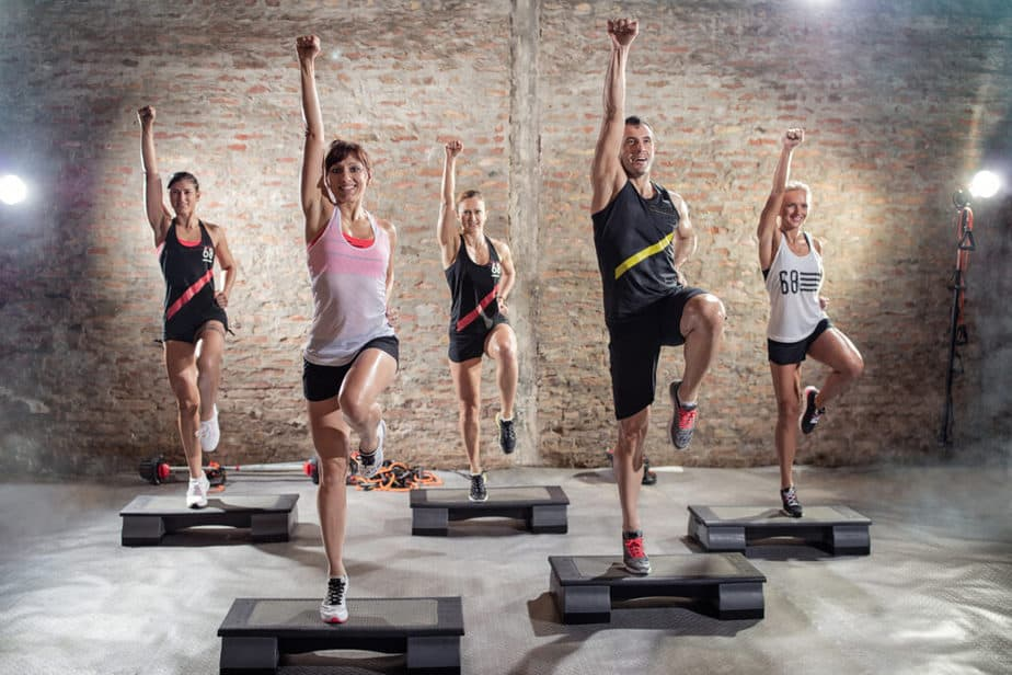 Aerobics class, group of people doing exercises.