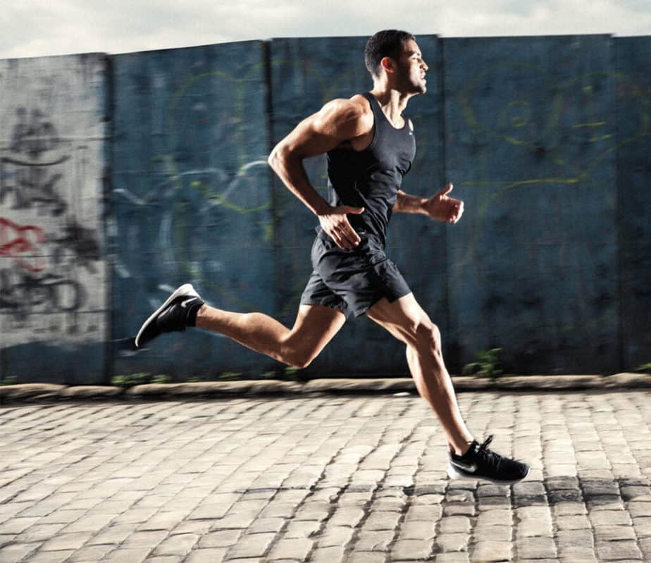 A guy is losing extra pounds by cardio training.