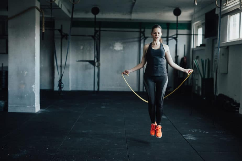 A girl has training with jumping rope.