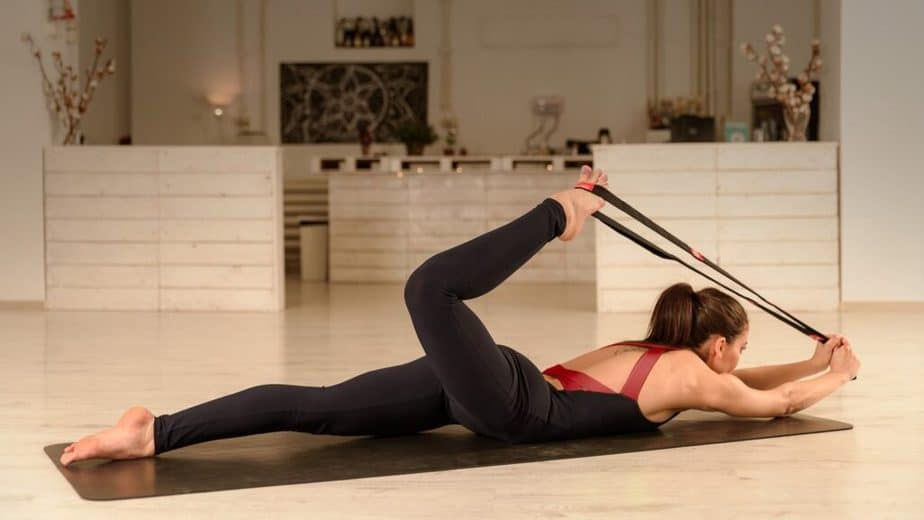 A girl has a training with stretching.