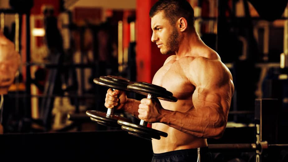 A guy has a workout with increasing power at the gym.