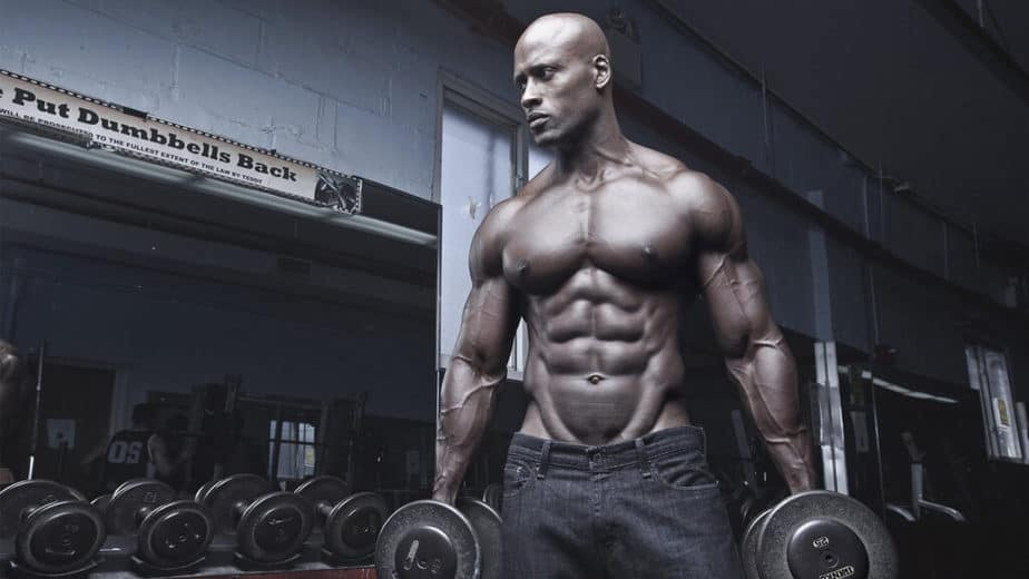 A guy has a bodybuilding training at the gym.