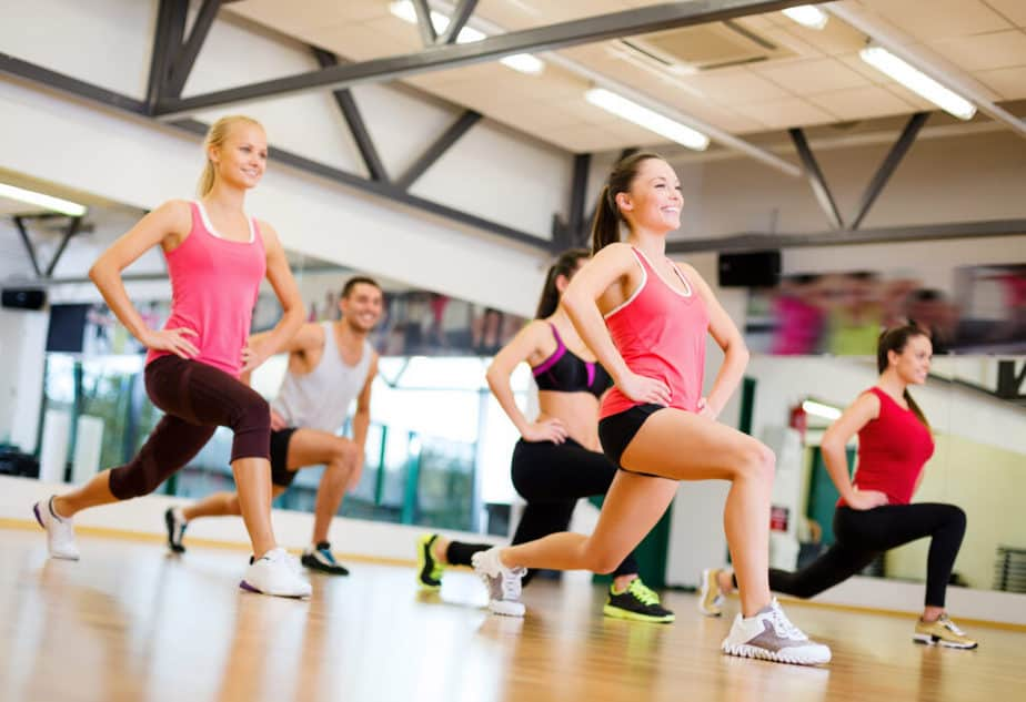 A group of young people have exercise at the gym.