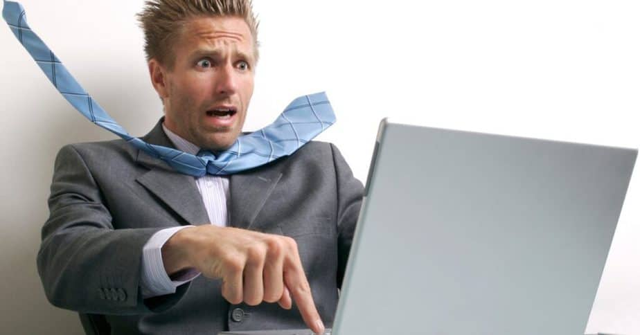 A guy is having a stress with broken computer.