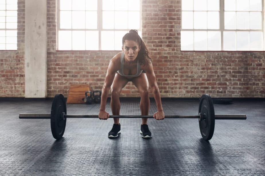 A girl has an exercise with a load. Avoiding Misconceptions