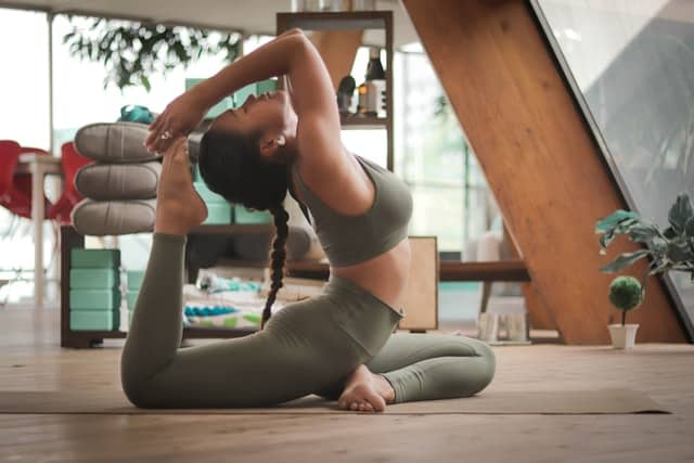 A woman doing yoga to physically prepare for relocation day.