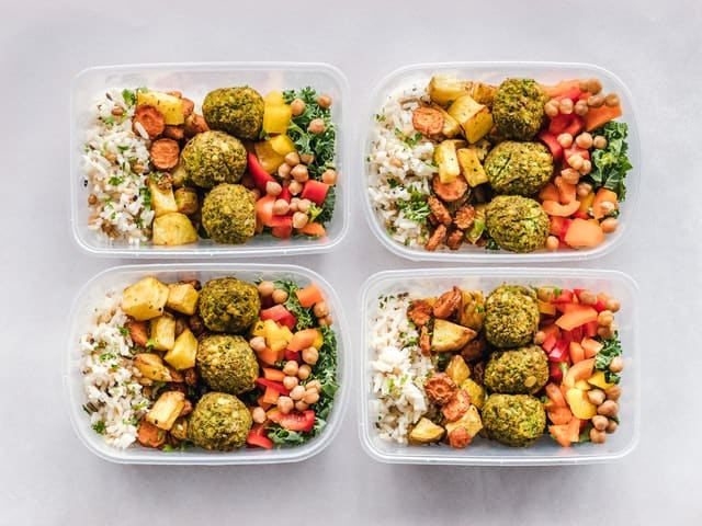 Four containers filled with delicious food that will help you physically prepare for the moving day.