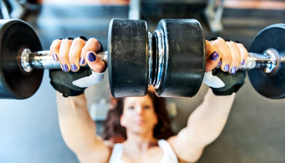 A girl is lifting weights for healthy living.