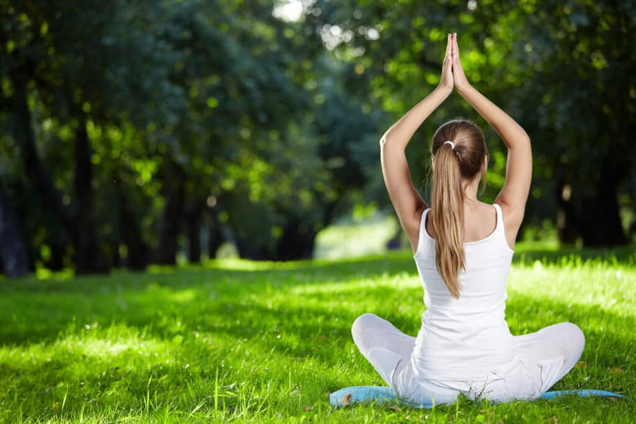 A girl is practicing yoga for healthy living.
