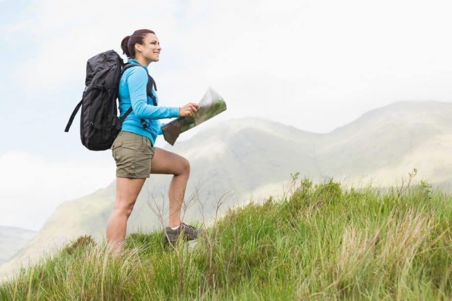 A girl is having cardio exercise by going up a hill .