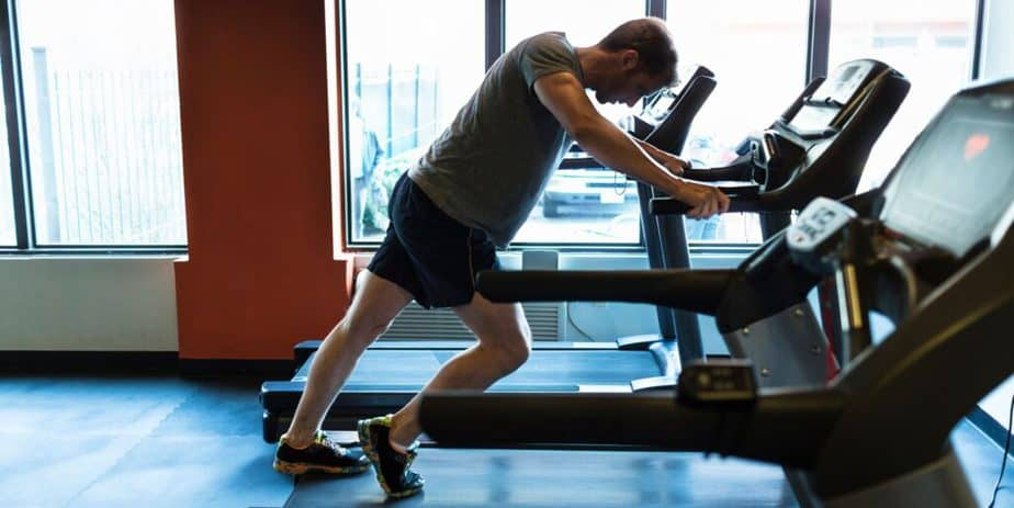 An exhausted guy on a treadmill.