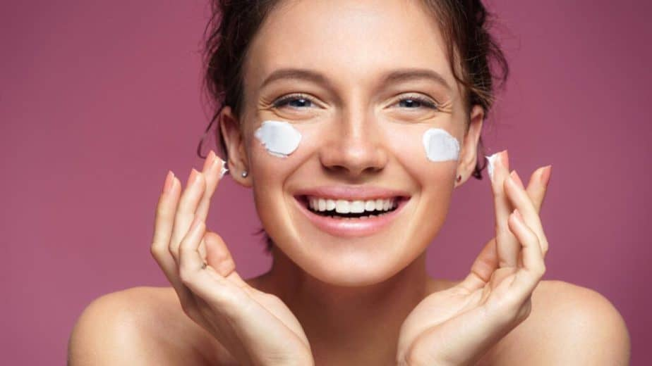 Want To Look Youthful And Rejuvenated At Any Age? Here's How - a girl using cream.
