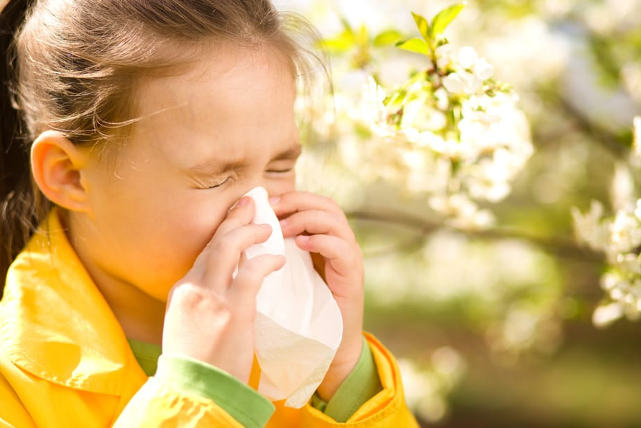 6 Home Remedies Every Parent Should Know About Seasonal Allergies  - kid sneezing.