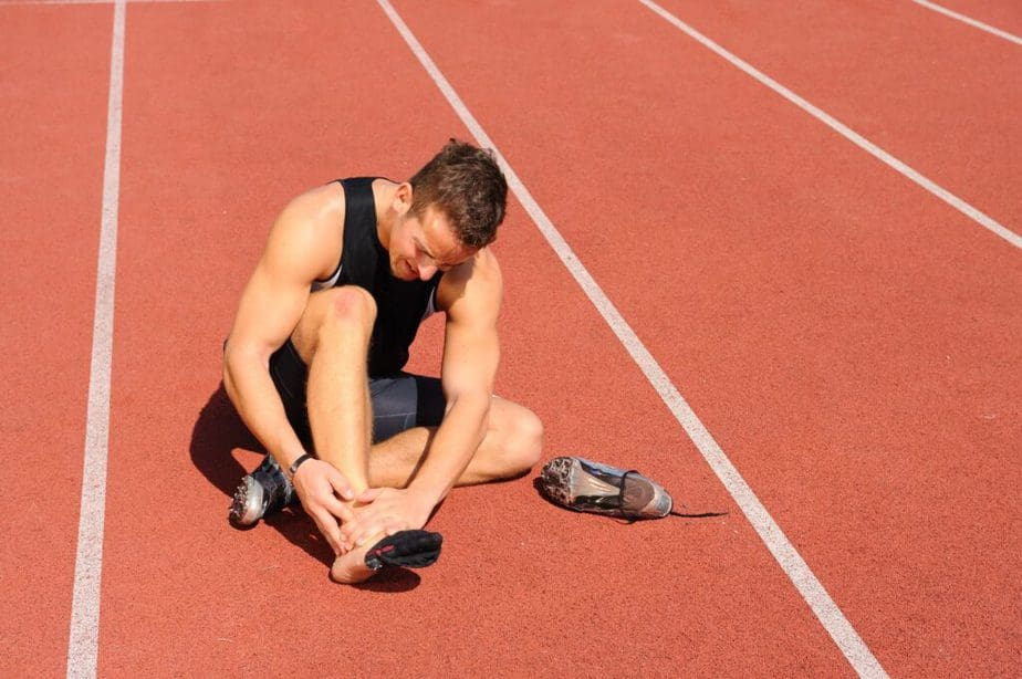 Tips on How to Stay Healthy as a Pro Athlete  - an athlete guy has an injury.