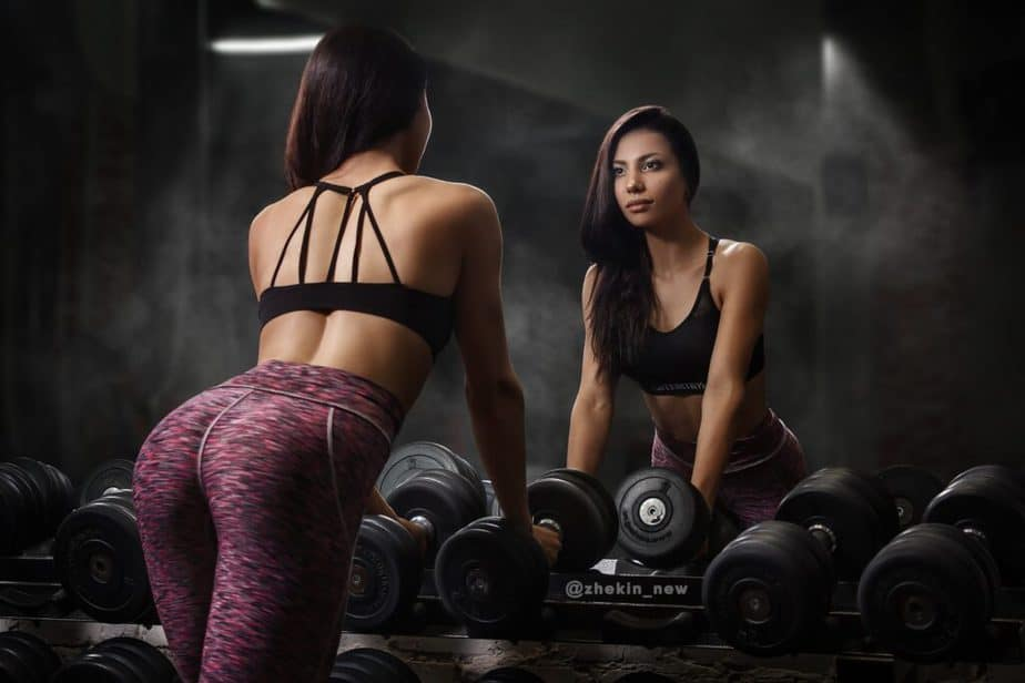 How to Get Energy and Motivation for Weight Loss? - A girl has a training in front of mirror.