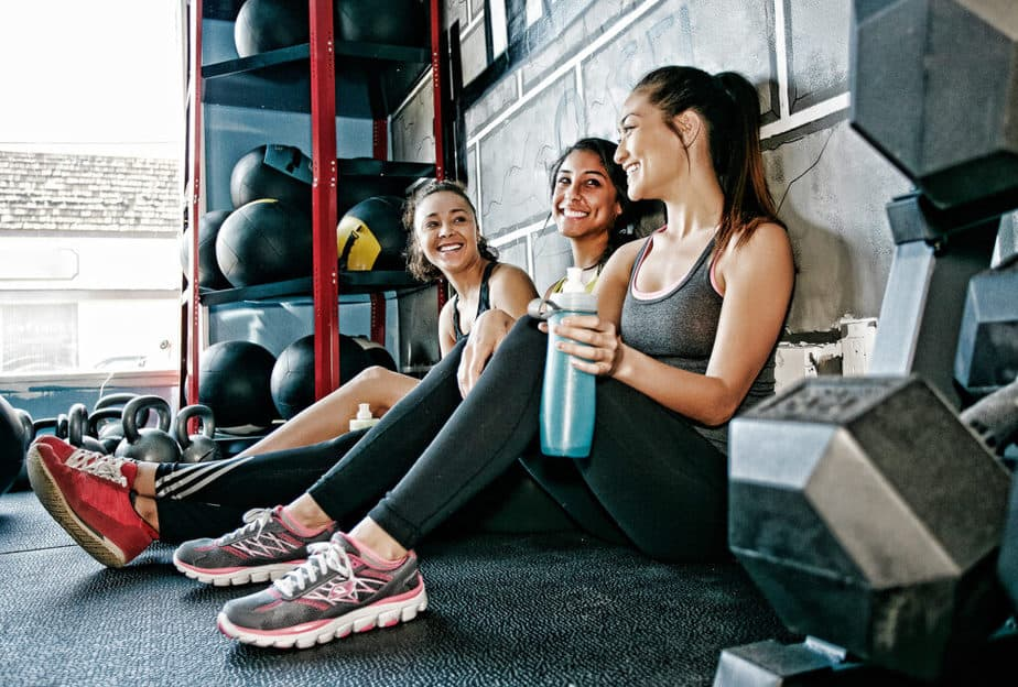 The better side of fitness - A girls resting together at the gym.