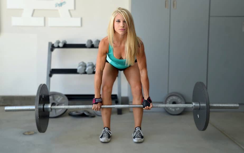 How to Achieve Good Results in Record Time - A girl has a weightlifting training at the gym.
