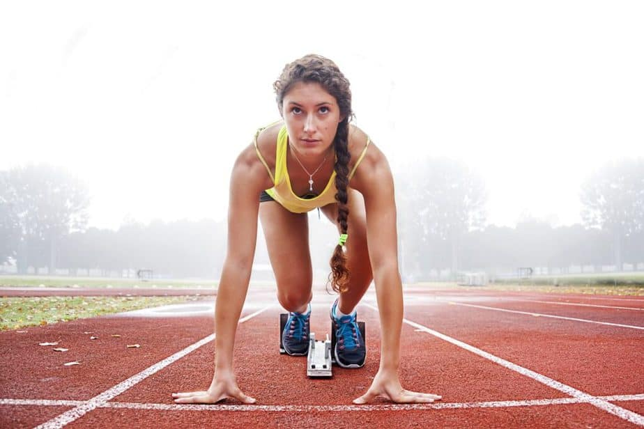 Want to Improve Your Athletic Performance - A girl is preparing for running.