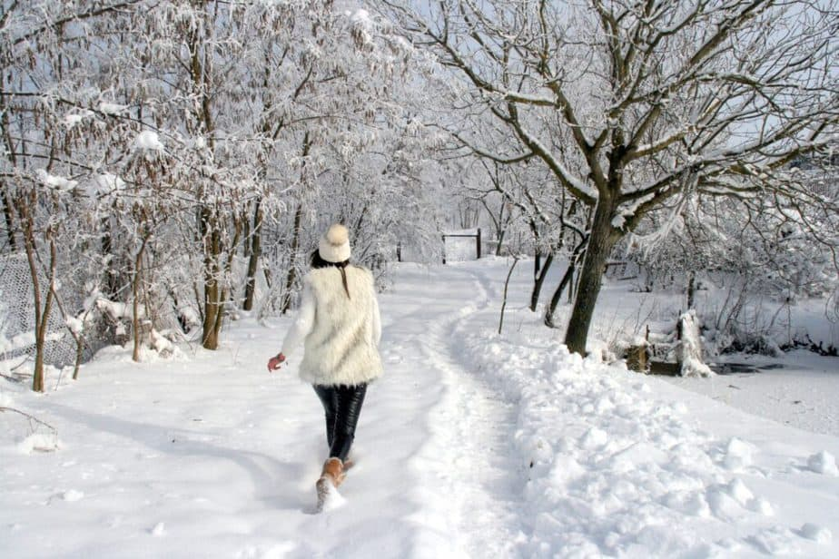 Holidays in Nature - a Healthy Way for Fat Burning - a girl is walking in snow.