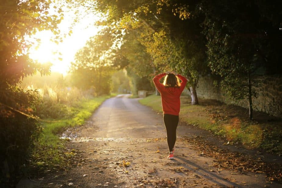 Change your life with sustainable health and fitness habits - A girl is walking outside.
