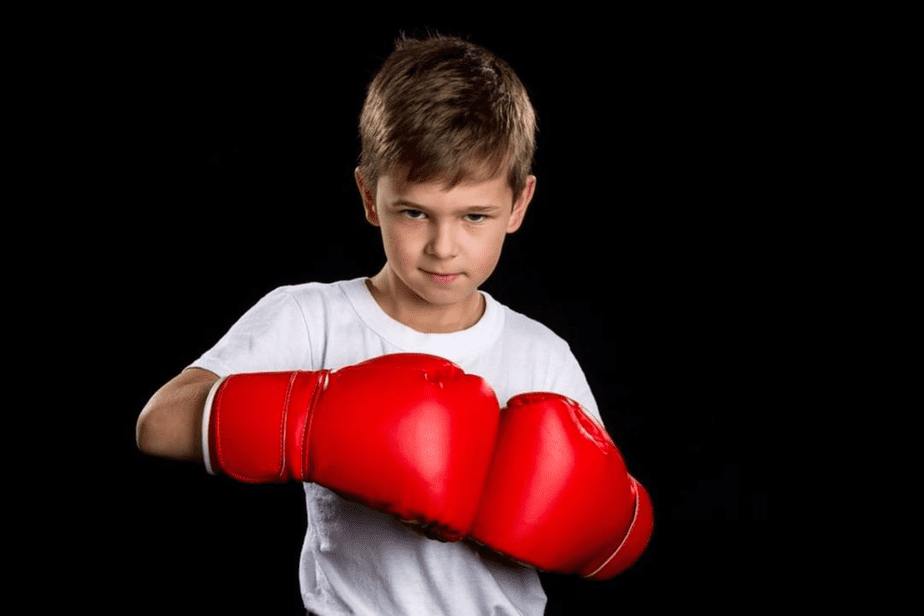 Guide on Boxing Gloves Sizes - A kid with his Boxing Gloves.